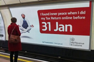 woman looking at tube station billboard showing a levitating man who has found inner peace by completing his tax return before the deadline