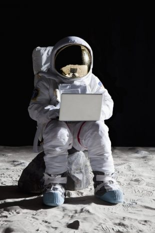 Astronaut-looking at laptop