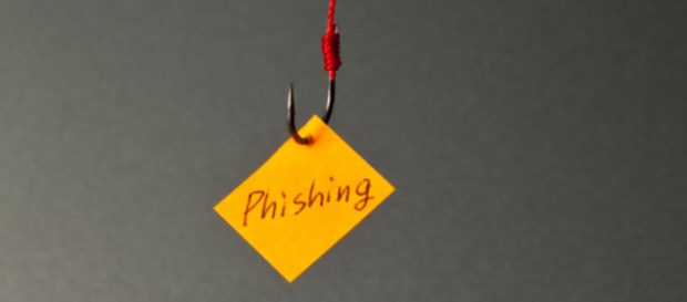 Fishing hook with a small yellow note with Phishing written on