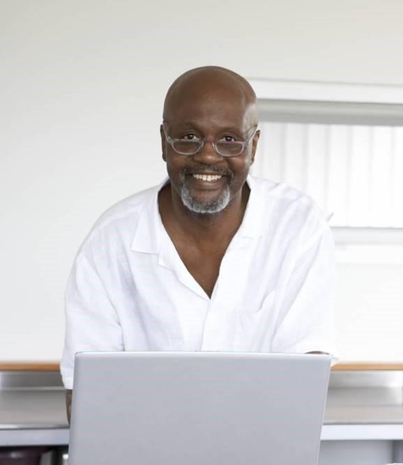 Smiling man with laptop