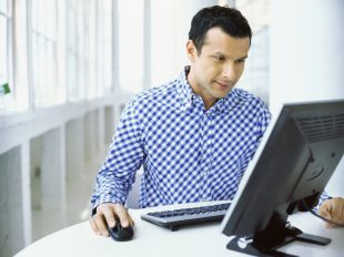 man sitting in front of a computer