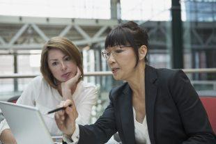 Businesswomen using a laptop