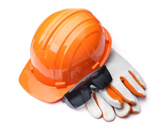 protective work-wear, orange hard hat, safety glasses and leather gloves on a white background